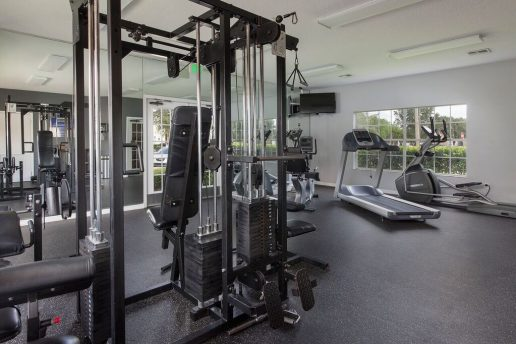 Fitness center with multiple workout equipment and TV